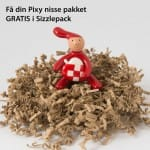 Pixy nisse med God Jul skilt